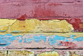 A fragment of a wall covered with old paint layers — Stock Photo