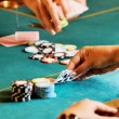 Stock Photo: Casino table with hands 2