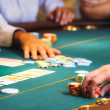 Stock Photo: Casino table with hands