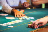 Casino table with hands — Stock Photo