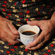 Hands Around a Coffee Cup — Stock Photo