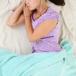 Young Girl is Sleeping in Her Bed - Stock Photo