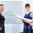 Stock Photo: Two Girls Students With a Graph