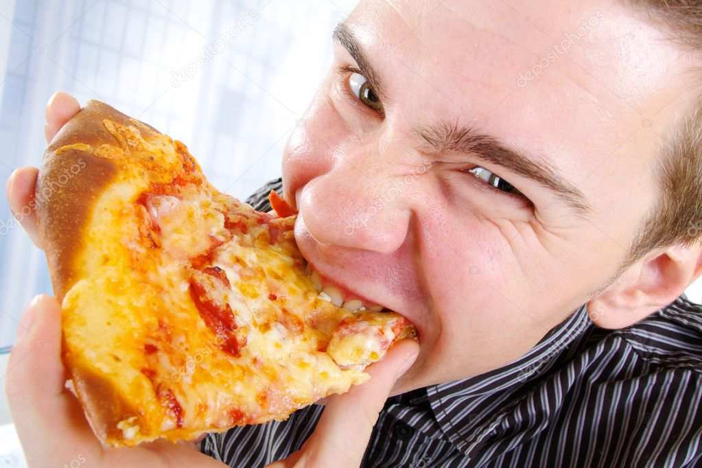 Close-Up Of A Young Man Eating A Slice Of Pizza — Stock Photo #4717542