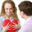 Royalty-Free Stock Photo: Woman Holding Paper Heart And Looking At Young Man