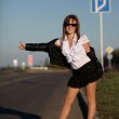 Young woman on the road — Stock Photo #3923843