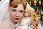 Bride with a doll — Stock Photo