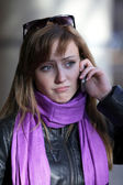 Upset woman with mobile phone — Stock Photo