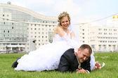 Bride sitting on the groom — Stock Photo