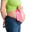 Pregnant belly with door-sign — Stock Photo