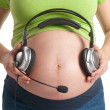 Royalty-Free Stock Photo: Pregnant belly with headphones