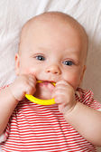 Cute baby with a teething ring — Stock Photo