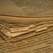 Royalty-Free Stock Photo: Closeup of an old book with tattered pages and slavonic text