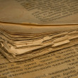 Stock Photo: Closeup of an old book with tattered pages and slavonic text