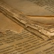Closeup of an old book with tattered pages and slavonic text — Stock Photo