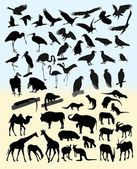 Many silhouettes of different animals and birds — Stock Vector