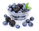 Glass of delicious blueberries and blackberries. — Stock Photo