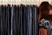 Woman buys clothes — Stock Photo