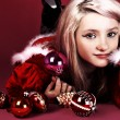 Portrait of beautiful sexy girl wearing santa claus clothes on red backgrou - Stock Photo