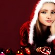 Portrait of beautiful sexy girl wearing santa claus clothes on red backgrou — Stock Photo #4462620