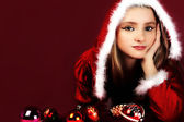 Portrait of beautiful sexy girl wearing santa claus clothes on red backgrou — Stock Photo