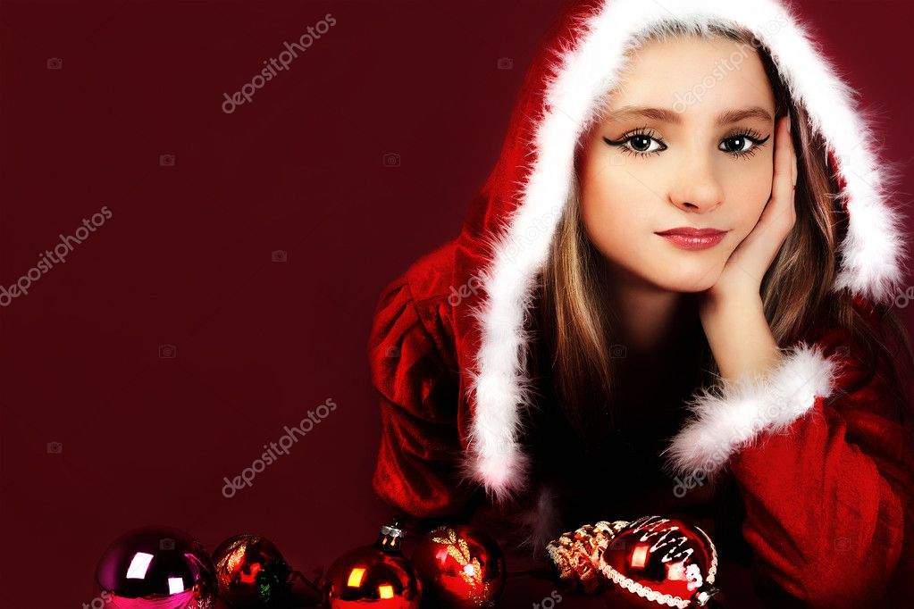 Portrait of beautiful sexy girl wearing santa claus clothes on red background  Stock Photo #4462620