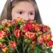 Stock Photo: Little girl with rose.