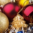 Stock Photo: Christmas toys on background of garlands