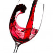 Red wine is poured into a glass. Closeup. Isolated on white back — Stock Photo