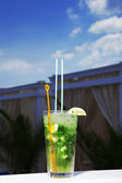 A glass of mojito cocktail with mint on sky background — Stock Photo