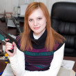 Armed woman at office - Foto de Stock