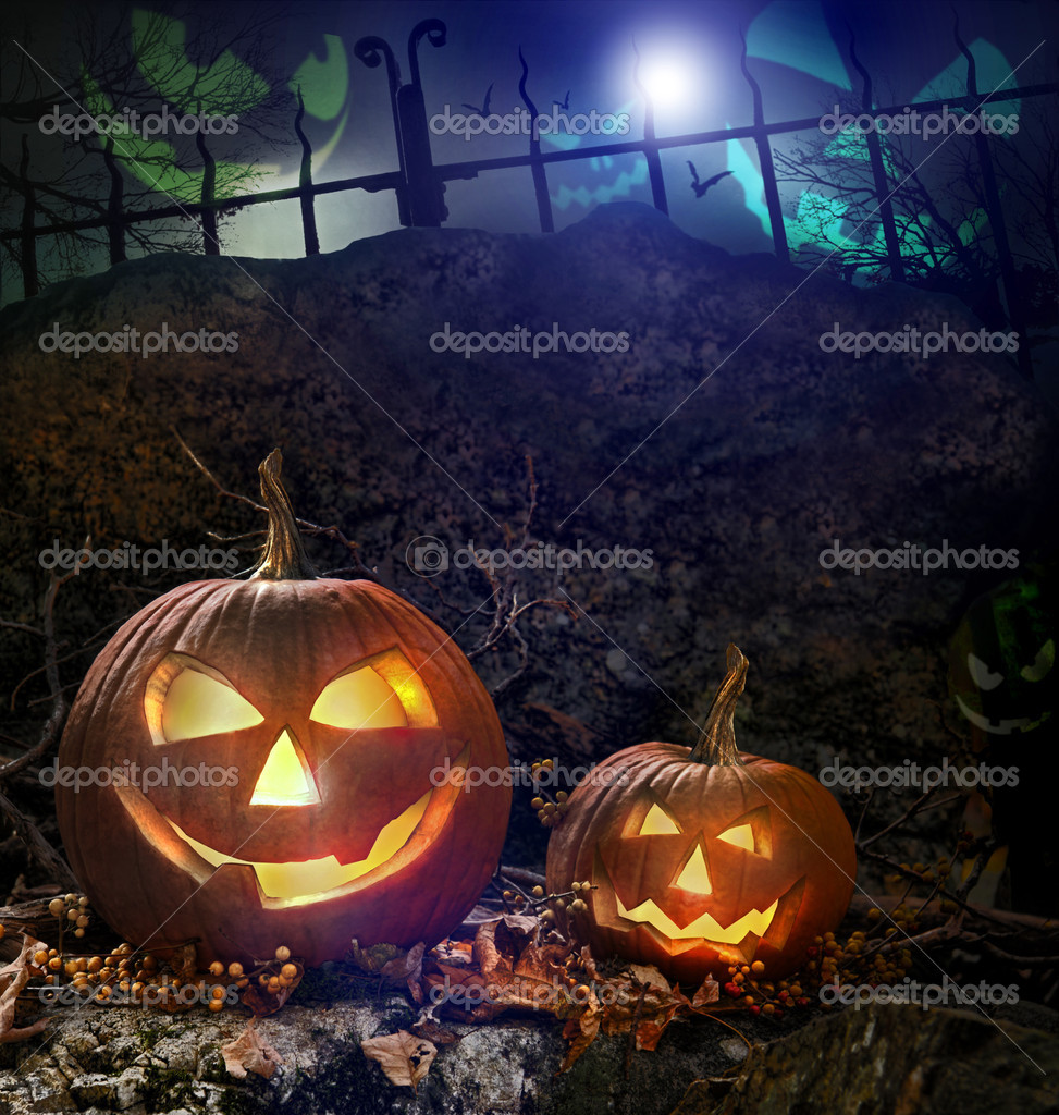 Halloween pumpkins on rocks in a forest at night — Stock Photo #4039325