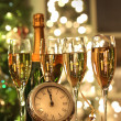 Four glasses of champagne ready for the New Year - Stock Photo