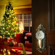 Door opening into a Christmas living room - Stok fotoğraf