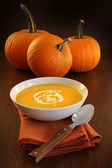 Delicious pumpkin soup with cream — Stock Photo