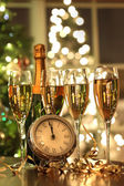 Four glasses of champagne ready for the New Year — Stock Photo