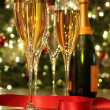 Glasses of champagne with red ribbon — Foto Stock