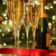 Glasses of champagne with red ribbon — Stok fotoğraf