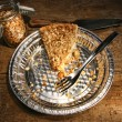 Last piece of apple crumble pie in aluminum  plate - Stock Photo