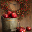 Stockfoto: Wood bucket of apples for the holidays