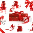 Photo: Different sizes of red ribbons and gift wrapped boxes on white