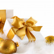 Gold ribbon gifts with Christmas balls — Stock Photo #4340719