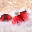 Red Christmas balls with abstract background — Stock Photo