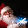 Santa holding magical lights in hands — Stock Photo