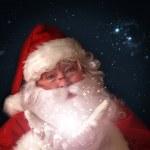 サンタの魔法のクリスマス ライトの手で保持 — ストック写真