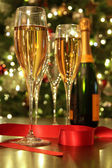 Glasses of champagne with red ribbon — Stock Photo