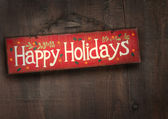 Holiday sign on distressed wood wall — Stok fotoğraf