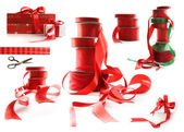 Different sizes of red ribbons and gift wrapped boxes on white — Zdjęcie stockowe