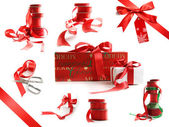 Different sizes of red ribbons and gift wrapped boxes on white — Стоковое фото