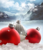 Three red Christmas balls in the snow — Stok fotoğraf